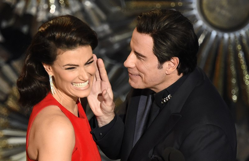 John Travolta (R) and Idina Menzel present an award on stage at the 87th Oscars February 22, 2015 in Hollywood, California. AFP PHOTO / Robyn BECK / AFP PHOTO / ROBYN BECK (Photo credit should read ROBYN BECK/AFP/Getty Images)