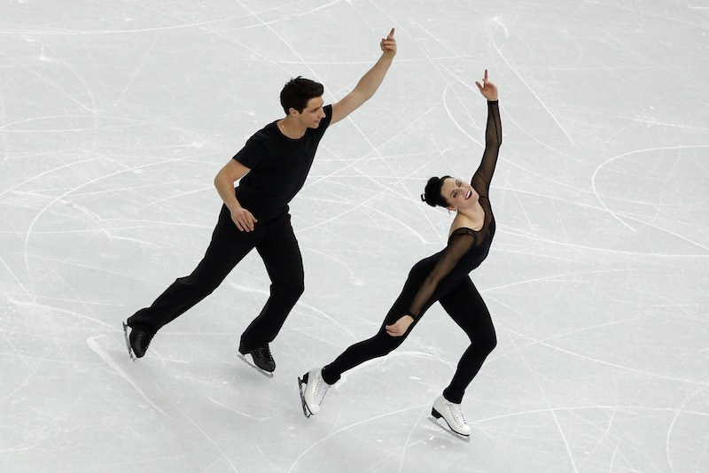 Canada's Olympic ice dance champions Scott Moir and Tessa Virtue perform an ice dance routine during a training session at the Iceberg Skating Palace on February 5, 2014, ahead of the 2014 Sochi Winter Olympics. The opening ceremony of the Sochi Olympic Winter will take place on February 7, 2014. AFP PHOTO/ADRIAN DENNIS (Photo credit should read ADRIAN DENNIS/AFP/Getty Images)