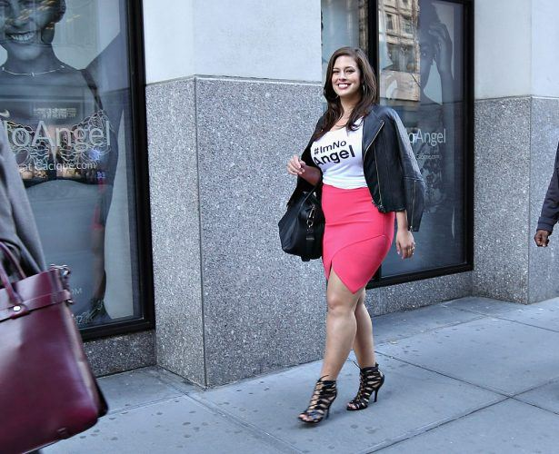 Ashley Graham walking in New York City while promoting a fashion line.