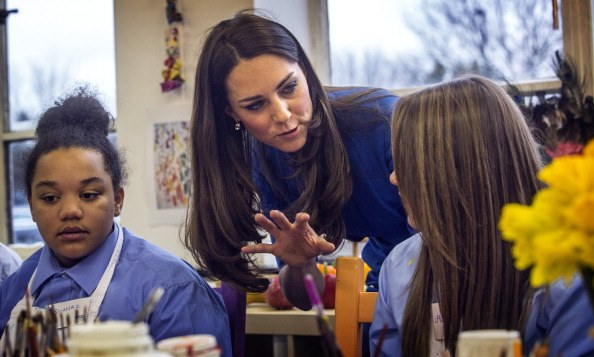 Catherine, Duchess of Cambridge talks to students during the opening of the ICAP Art Room at Northolt High School on February 14, 2014.