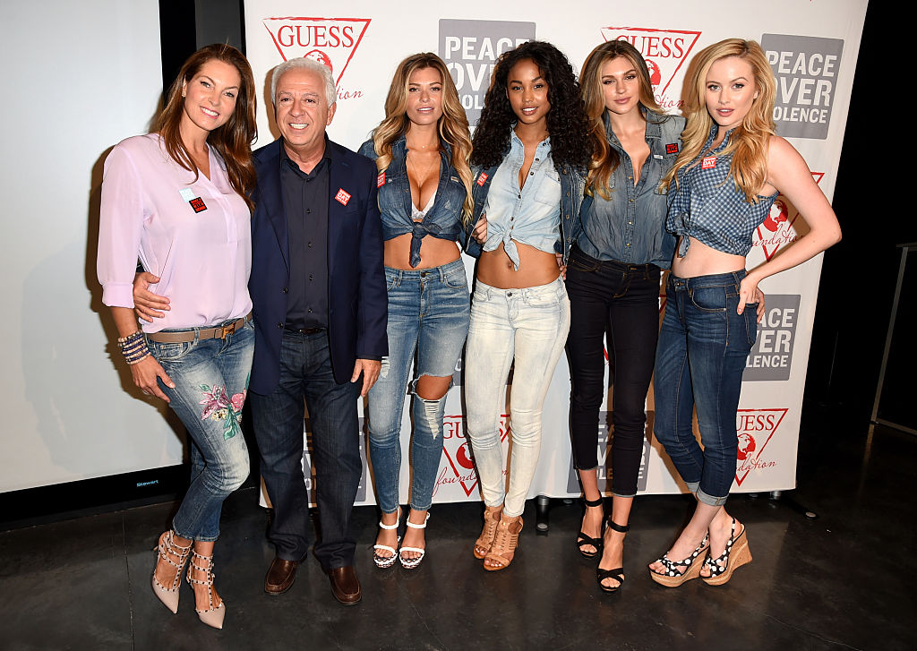 Paul Marciano with his wife, Mareva Georges Marciano (left), and GUESS models