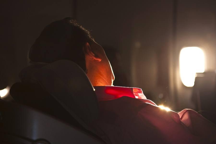 man sleeping in airplane