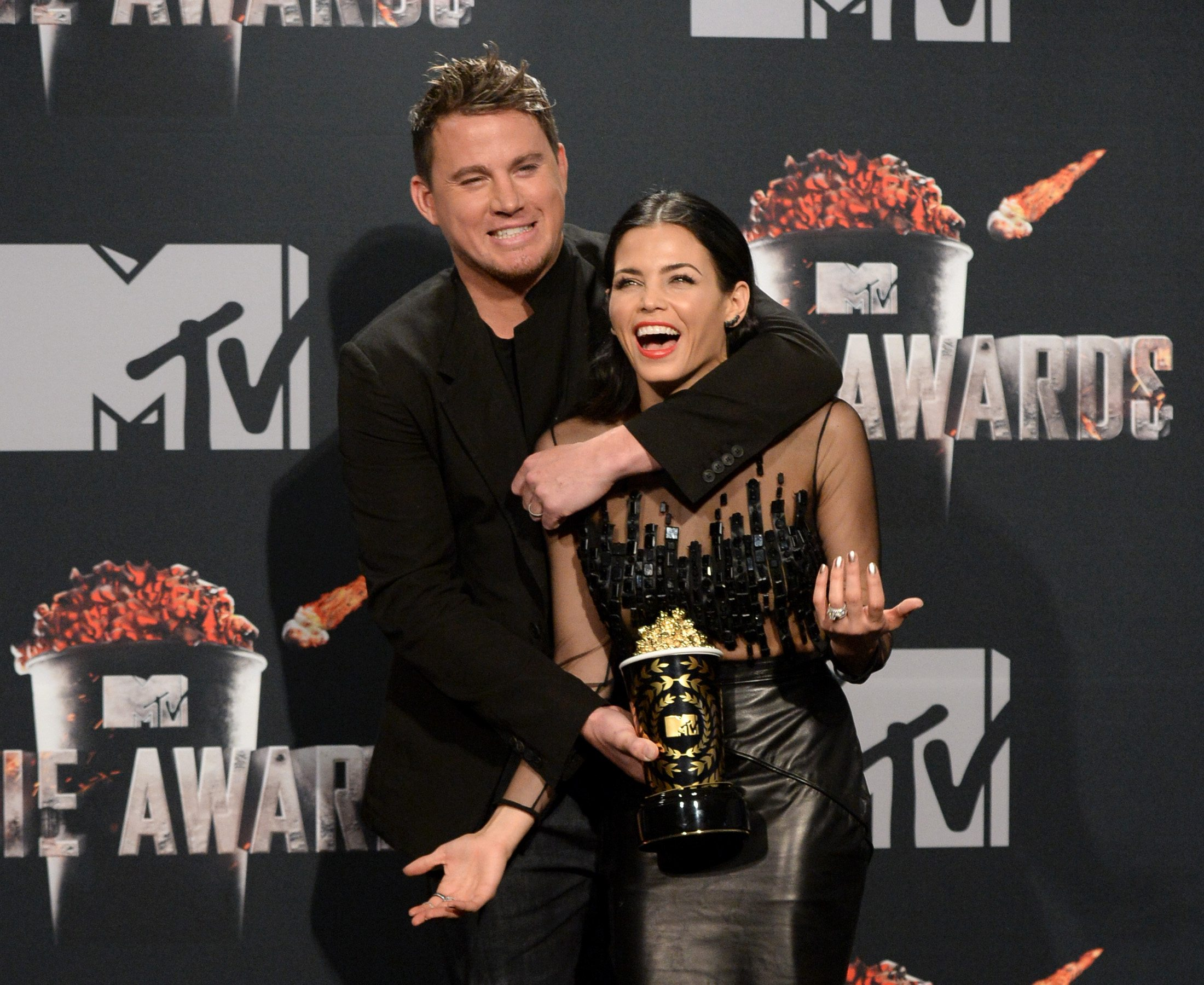 Honoree Channing Tatum (L, holding Trailblazer Award) and actress Jenna Dewan Tatum pose in the press room during the 2014 MTV Movie Awards at Nokia Theatre L.A. Live on April 13, 2014 in Los Angeles, California.