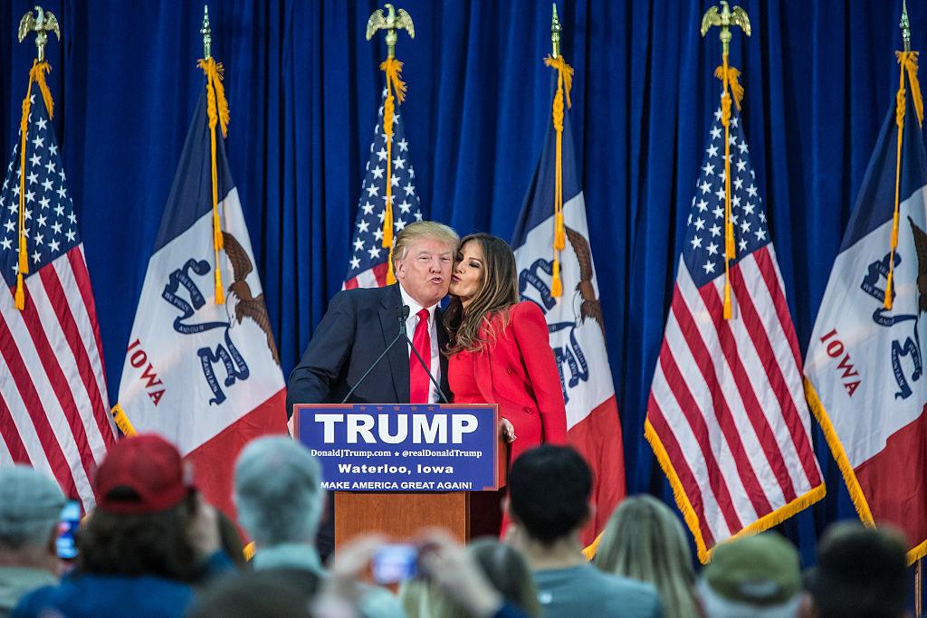 melania and donald trump at a rally