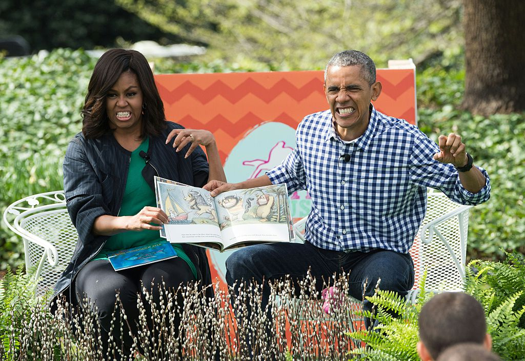 """US President Barack Obama and First Lady Michelle Obama read Maurice Sendak's """"Where the Wild Things Are"""" to children at the annual Easter Egg Roll at the White House"""