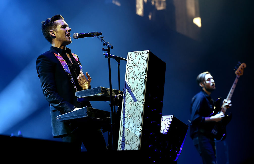 Musicians Brandon Flowers and Mark Stoermer of The Killers perform onstage during the grand opening of T-Mobile Arena on April 6, 2016 in Las Vegas, Nevada.