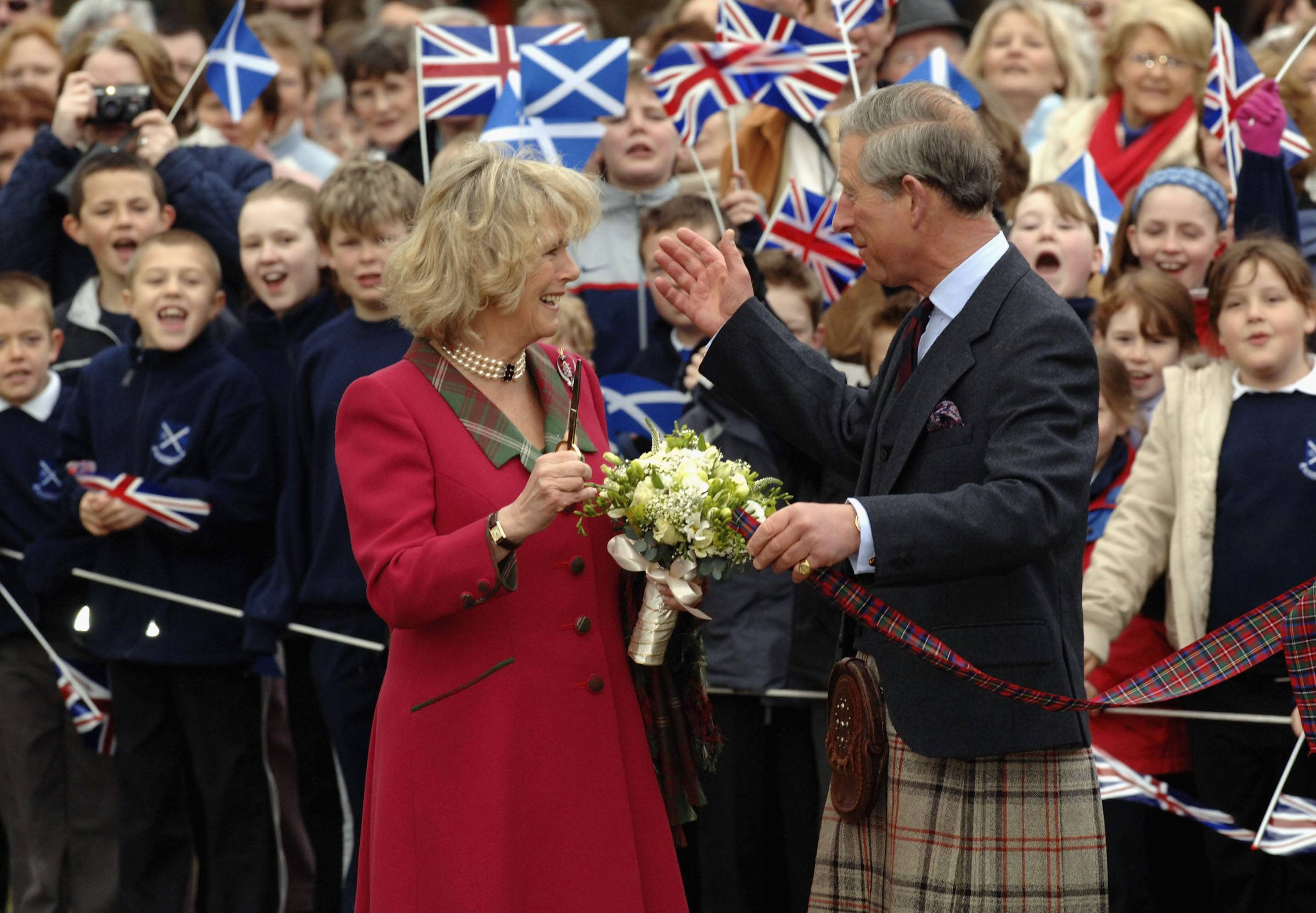 TRH Prince Charles, the Prince of Wales, and his wife Camilla, the Duchess of Cornwall, in their role as the Duke and Duchess of Rothesay, take time out from their honeymoon at Birkhall on the Queen's Aberdeenshire estate, to undertake their first joint official engagement opening Monaltrie Park children's playground in Ballater near Balmoral on April 14, 2005 in Aberdeenshire, Scotland.