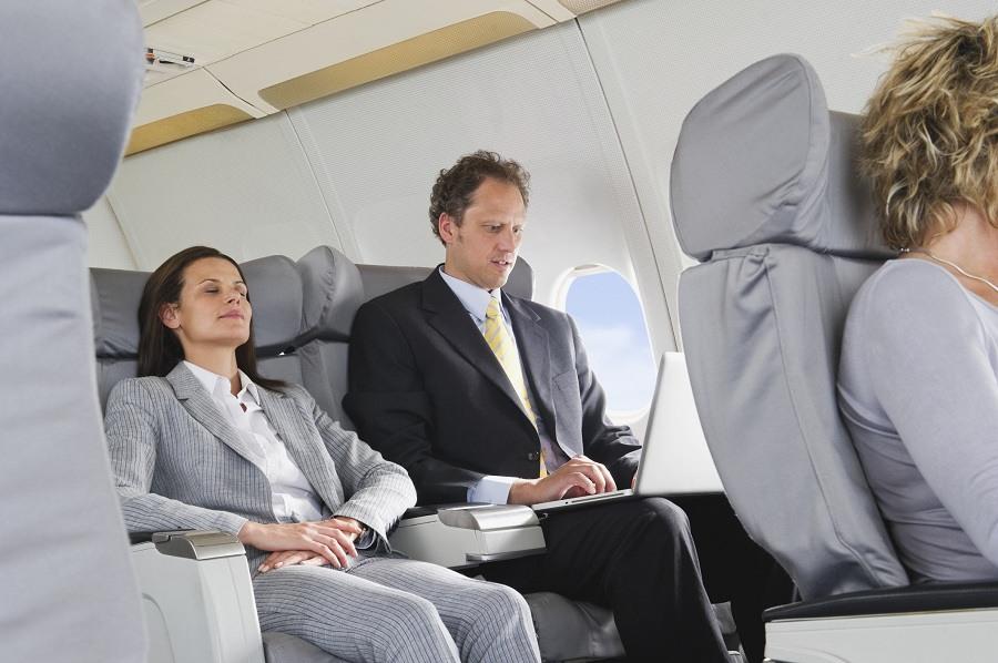 Woman sleeping in aeroplane on reclining seat