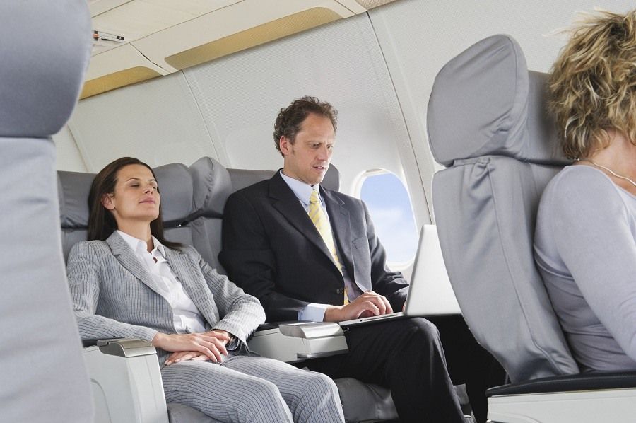 Woman sleeping in aeroplane on reclining seat