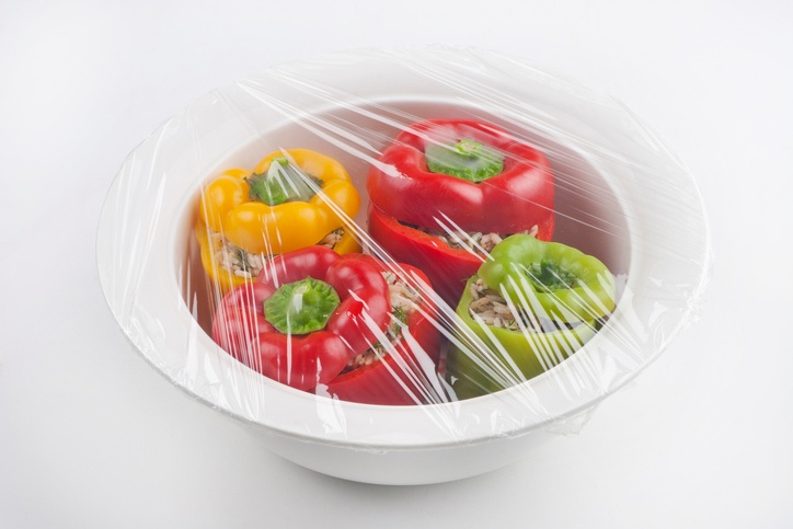 Stuffed peppers covered in plastic wrap