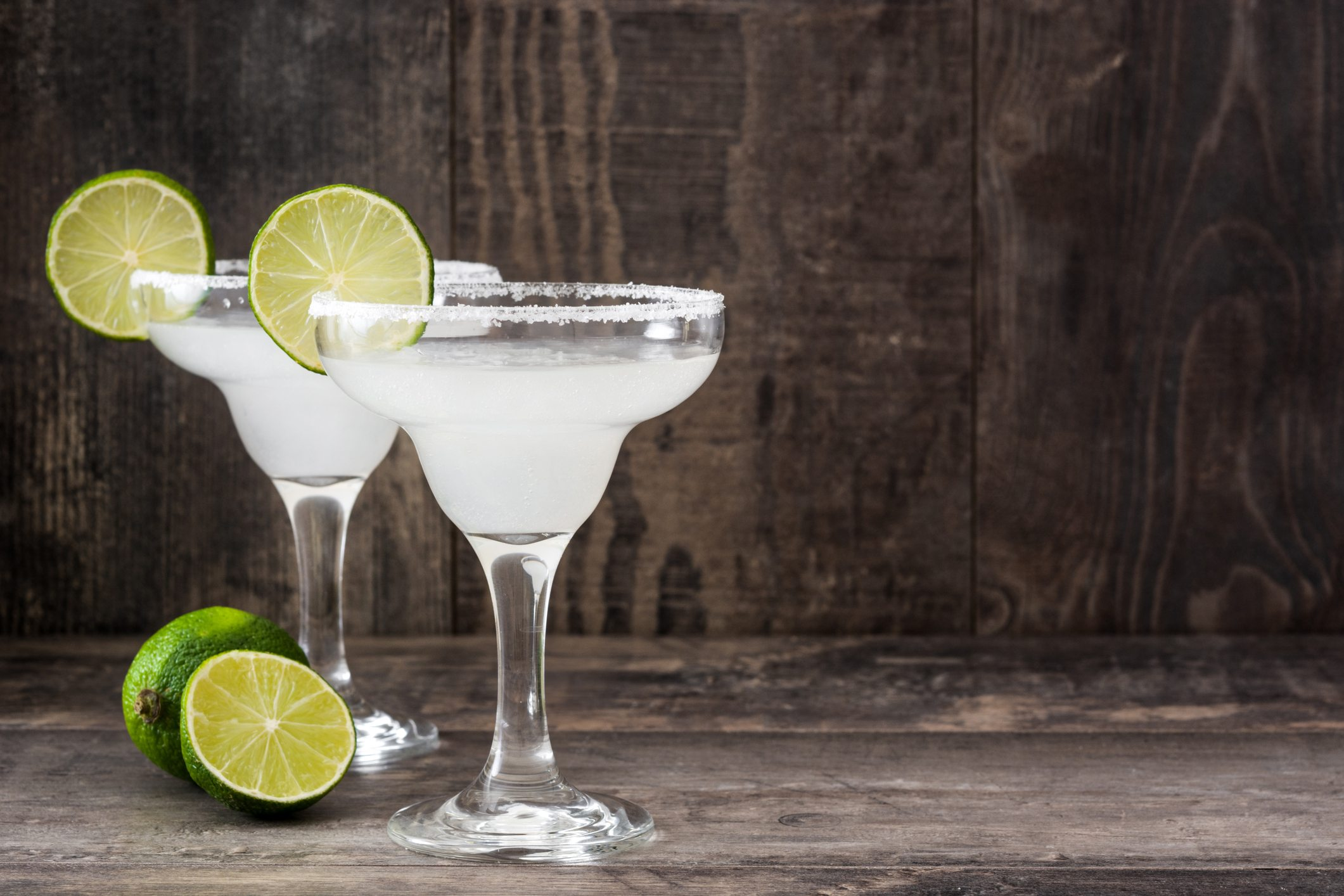 Margarita cocktail on white wooden table