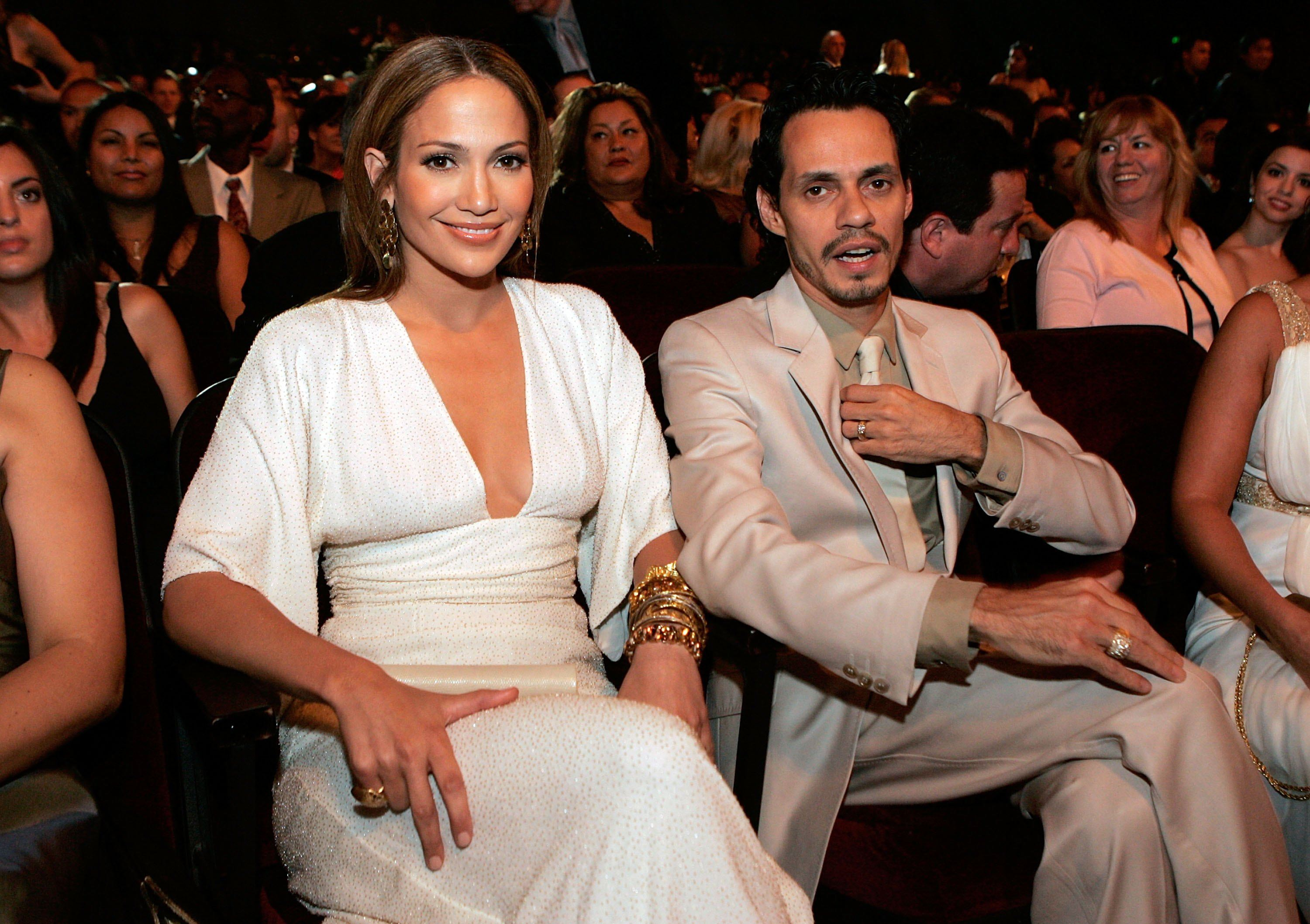 Actress/Singer Jennifer Lopez (L) and Marc Anthony in the audience at the 2006 NCLR ALMA Awards at the Shrine Auditorium on May 7, 2006 in Los Angeles, California.