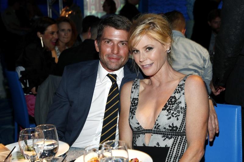 Scott Phillips sits with Julie Bowen at an awards dinner.