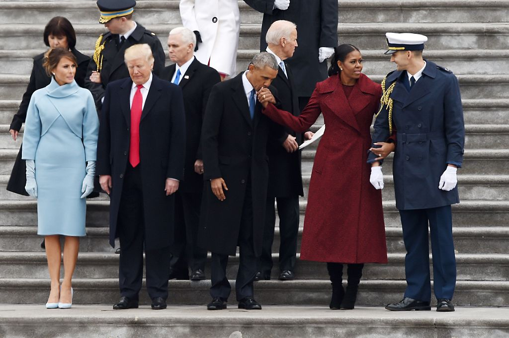 obama kisses michelle's hand with trumps next to him