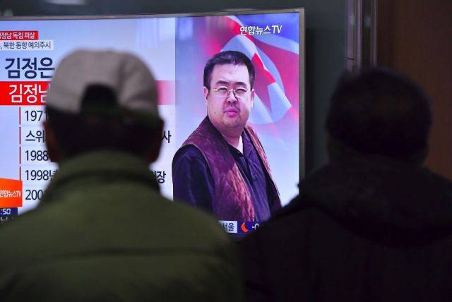 Spy Weapons. People watch a television showing news reports of Kim Jong-Nam, the half-brother of North Korean leader Kim Jong-Un, at a railway station in Seoul