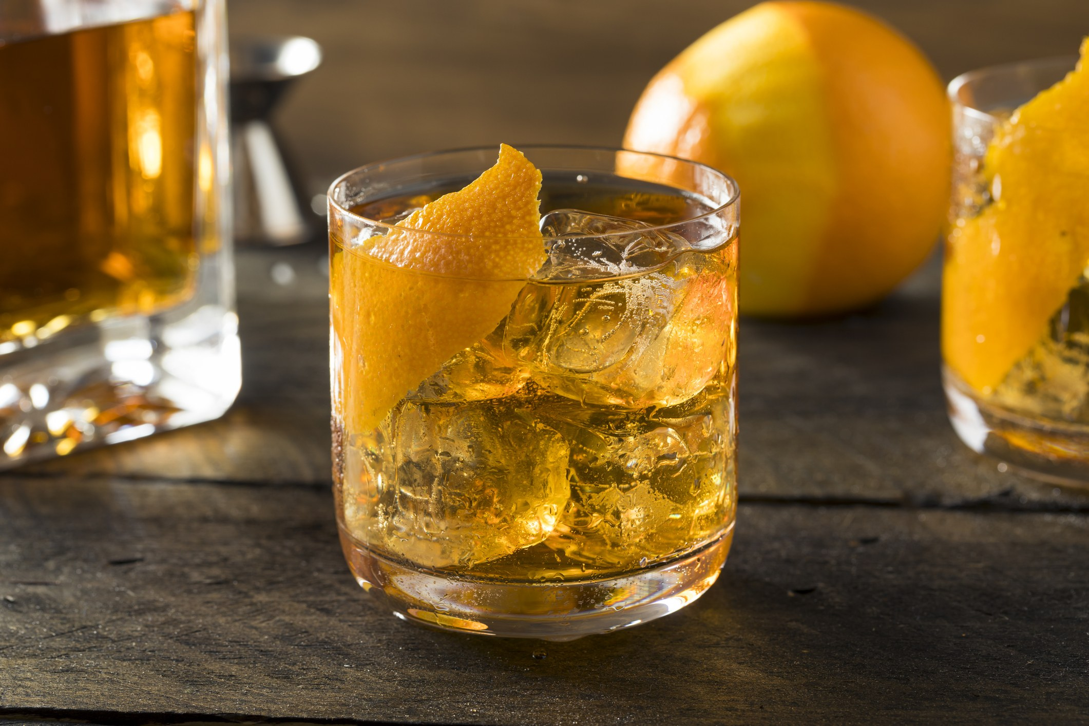 Homemade Old Fashioned Bourbon on the Rocks with an Orange Garnish