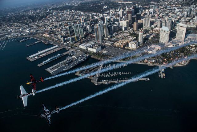 In this handout image provided by Red Bull, Mike Goulian of the United States leads Kirby Chambliss of the United States and Pete McLeod of Canada along the city skyline prior to the second stage of the Red Bull Air Race World Championship on April 11, 2017 in San Diego, California.