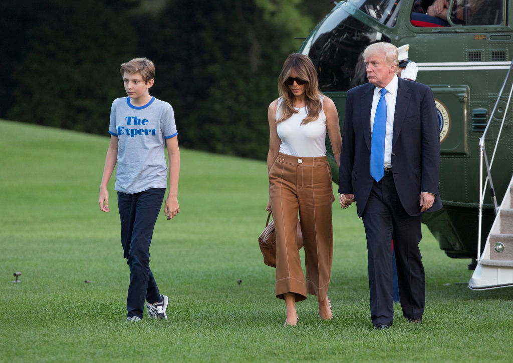 barron, melania, and donald trump arrive at the white house