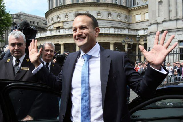 Leo Varadkar waves to colleagues as he leaves the parliament in Dublin after being confirmed as Taoiseach.