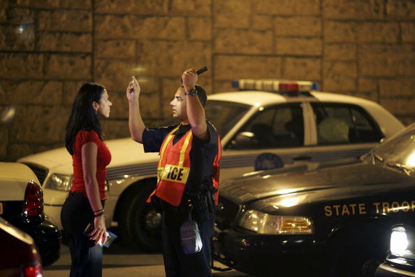 Officer Kevin Millan from the City of Miami Beach police department conducts a field sobriety test at a DUI traffic checkpoint December 15, 2006 in Miami, Florida. According to police, the woman failed a breathalyzer test by blowing into the device and receiving two readings one at .190 the other .183, which is twice the legal limit in Florida. The city of Miami, with the help of other police departments, will be conducting saturation patrols and setting up checkpoints during the holiday period looking to apprehend drivers for impaired driving and other traffic violations.