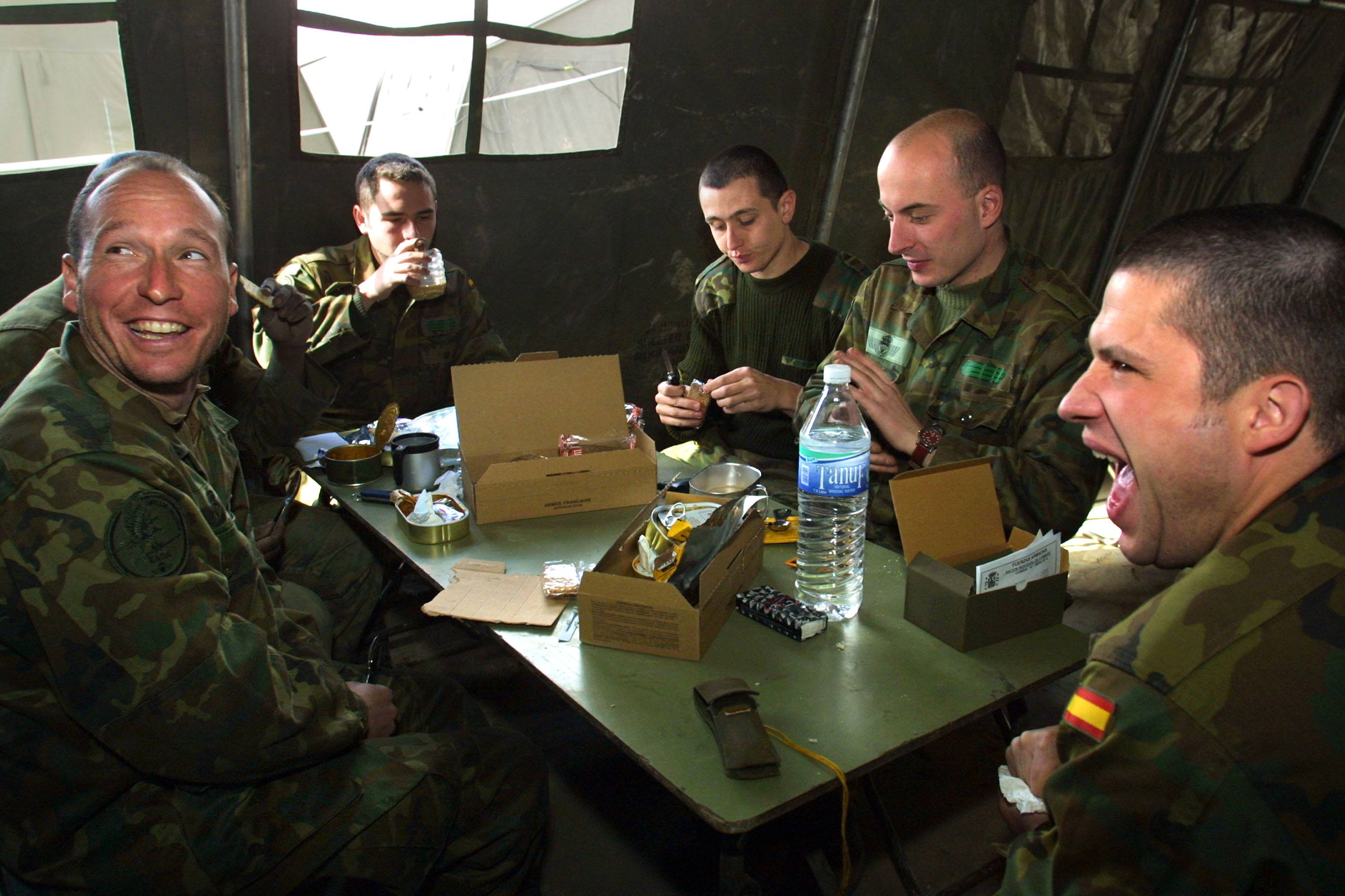 military members eat at a mess hall