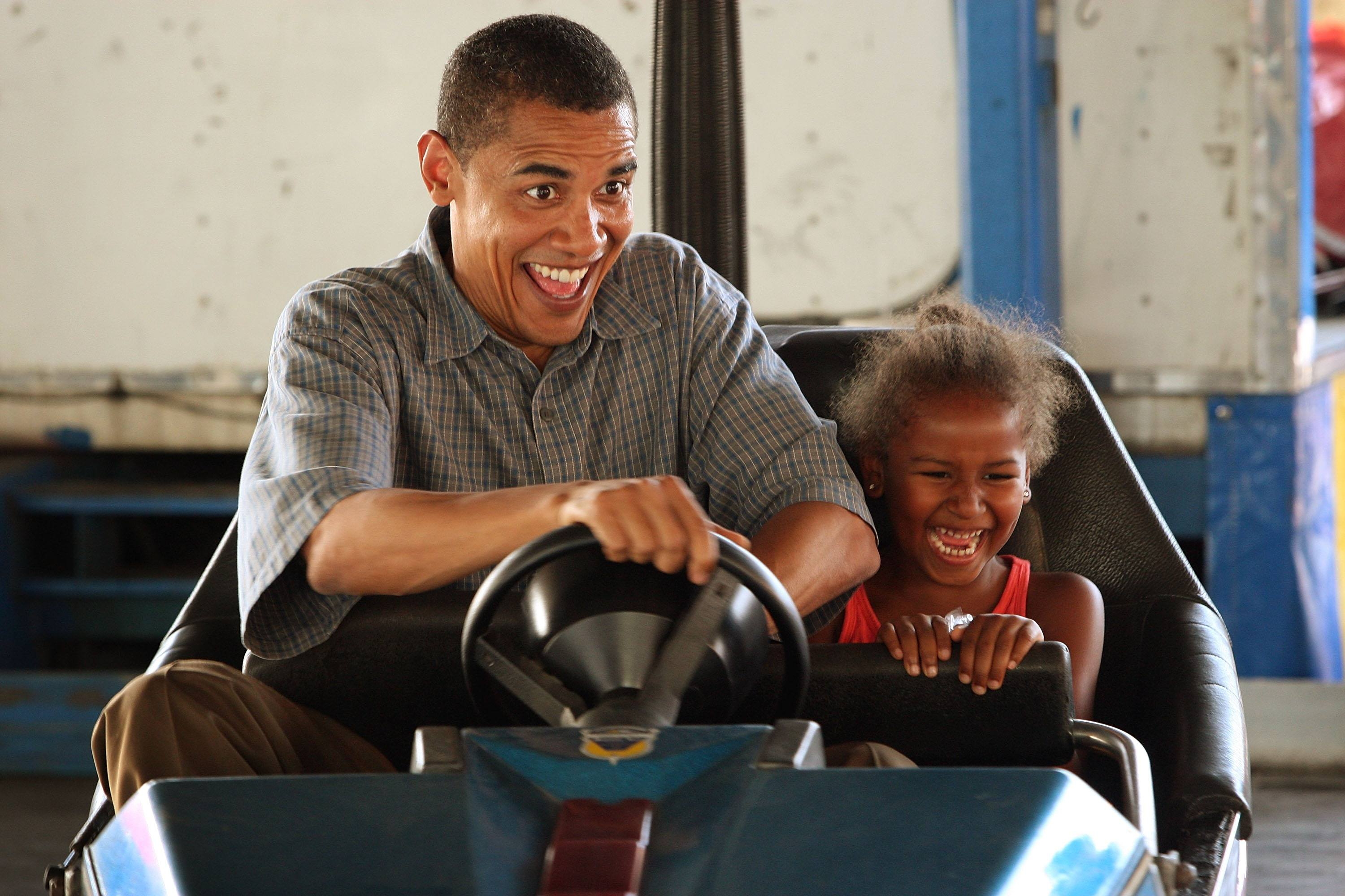 obama and sasha in a bumper car