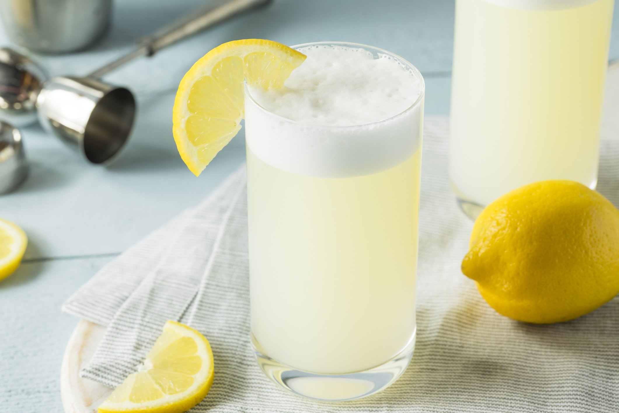 Refreshing Cold Egg Gin Fizz with a Lemon Garnish