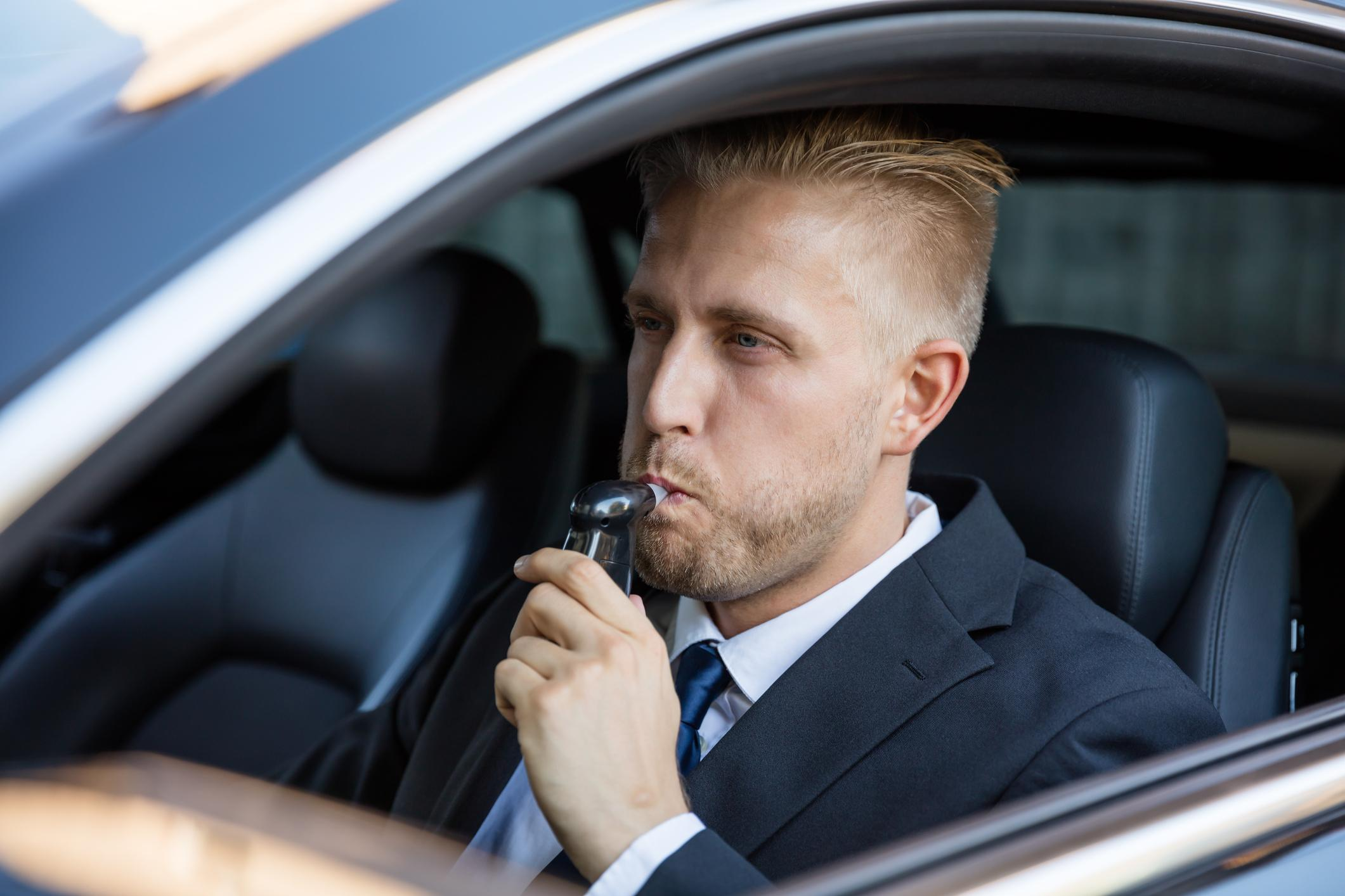 Man Taking Alcohol Test