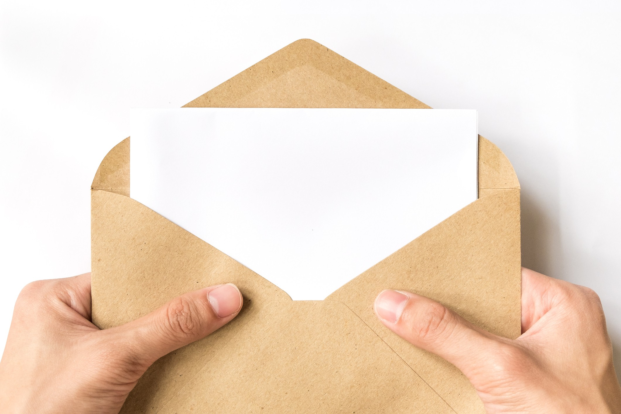 hand opening brown Envelope on white background