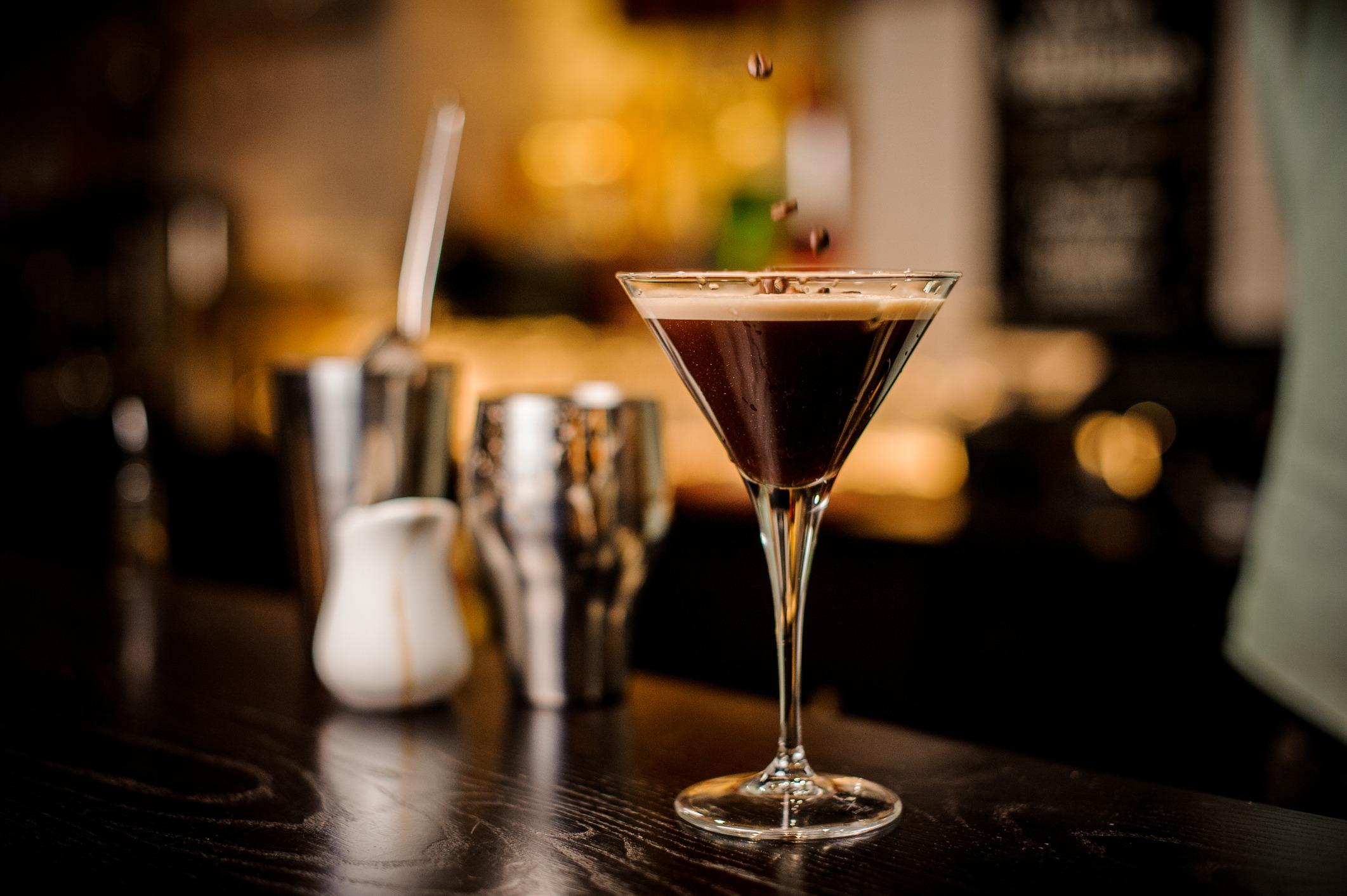 martini espresso cocktail drink foam coffee bean on top bar counter