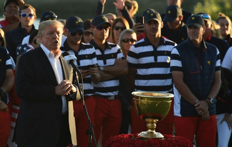 """US President Donald Trump speaks during the trophy presentation of the Presidents Cup golf championship at Liberty National Golf Club in Jersey City, New Jersey, after the United States clinched their 10th Presidents Cup on October 1, 2017. Trump arrived at the club -- some 30 miles from his home at his Trump National Bedminster resort -- just in time to see a US team described by International captain Nick Price as a """"juggernaut"""" seal the win."""