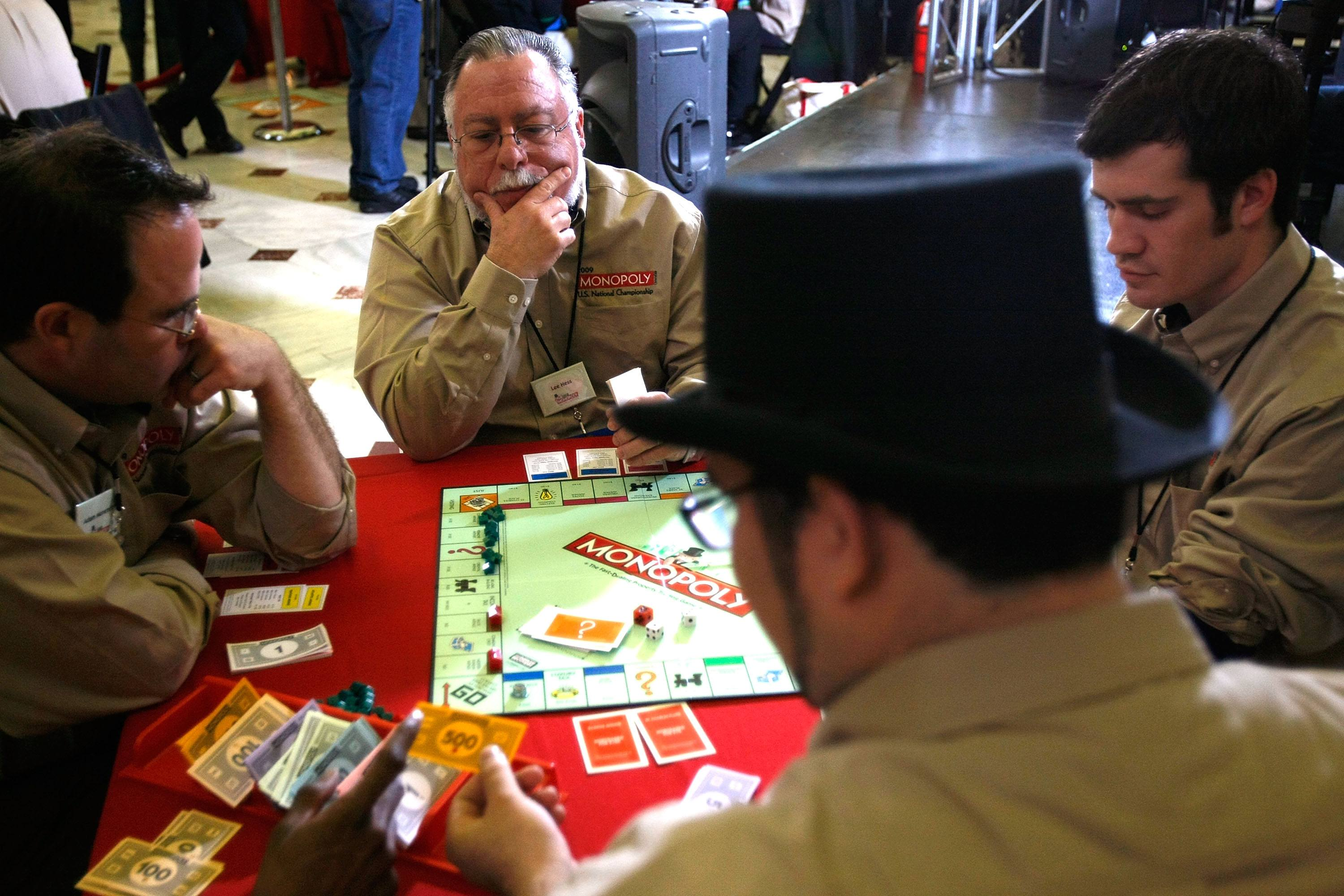 Players, clockwise from left, Adam Menendez of Portland, Oregon, Lee Hess of Westlake Village, California, Adam Thiel of West Yellowstone, Montana, and Hector Trujillo of El Segundo, California, compete during the Monopoly U.S. National Championship.