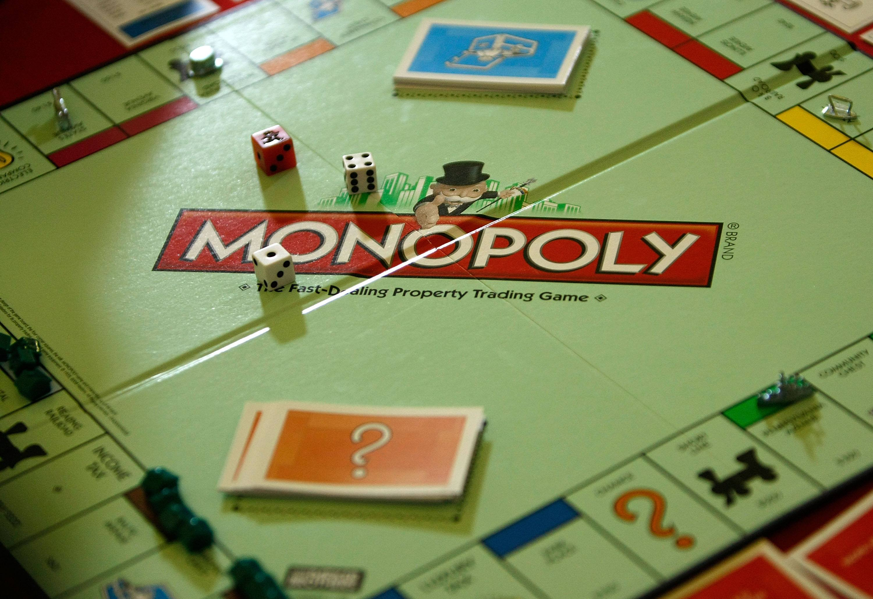 a monopoly board with pieces on it