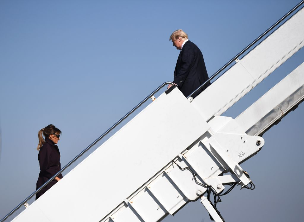 trump waits for melania at top of stairs