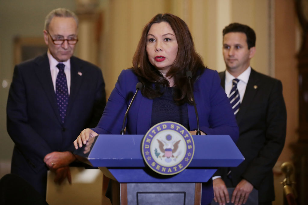 tammy duckworth at a podium