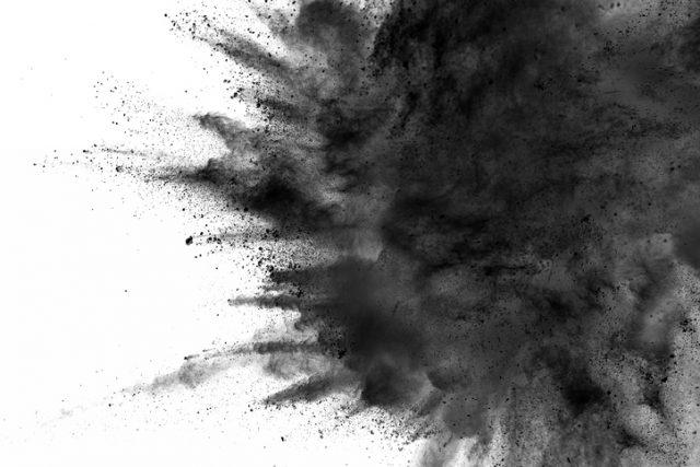 abstract black dust explosion on white background. Spy Weapons