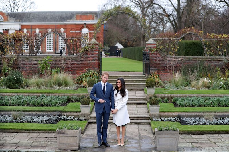 Britain's Prince Harry and his fiancée US actress Meghan Markle pose for a photograph in the Sunken Garden at Kensington Palace in west London on November 27, 2017, following the announcement of their engagement.