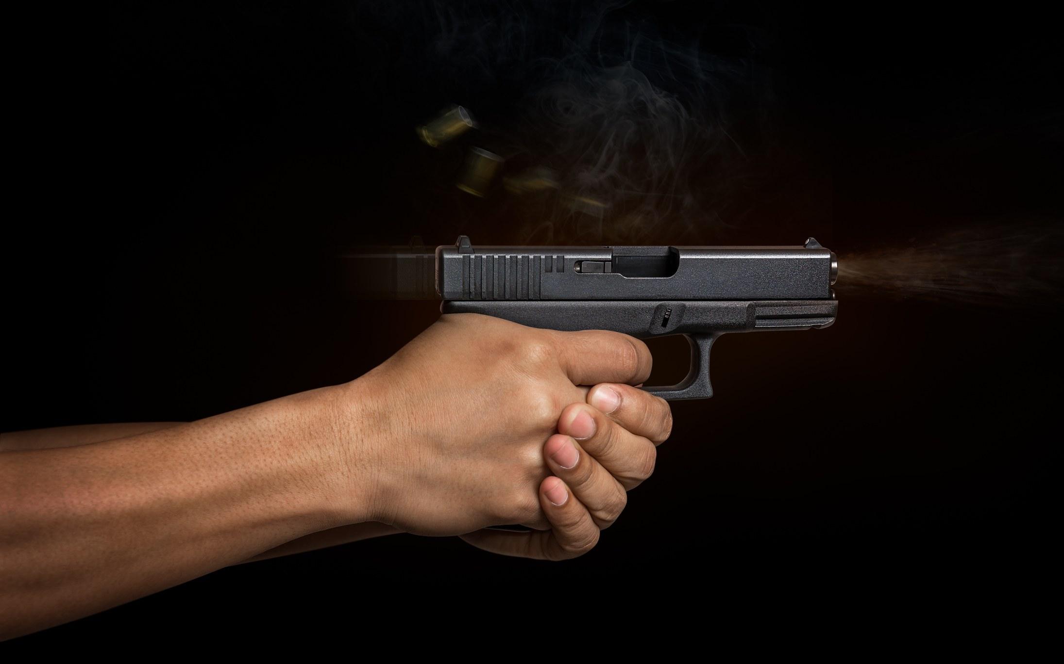 A hand firing a weapon.