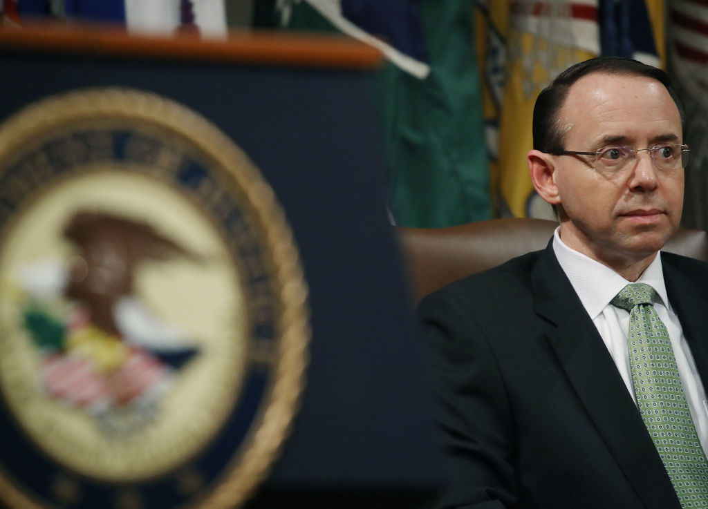 rod rosenstein in front of a department of justice seal