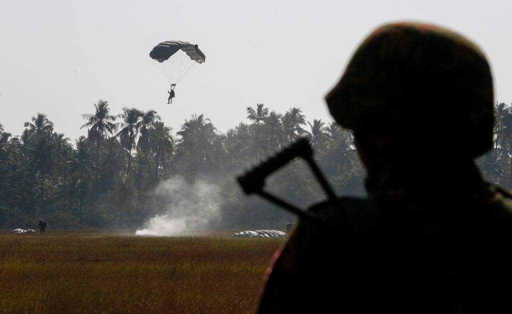 a parachute man lands during military exercises in myanmar