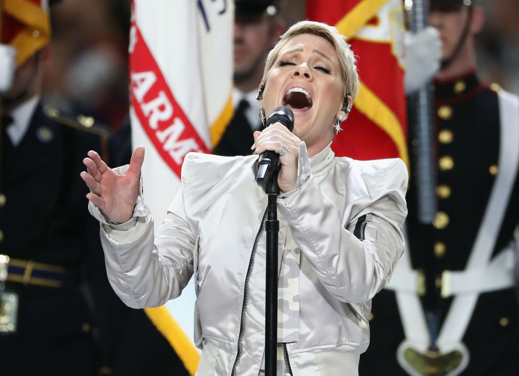 Pink sings the national anthem prior to Super Bowl LII between the New England Patriots and the Philadelphia Eagles at U.S. Bank Stadium on February 4, 2018 in Minneapolis, Minnesota.