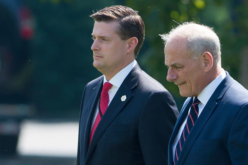 Kelly (R) and Porter (L)walk to Marine One prior to departure from the South Lawn of the White House