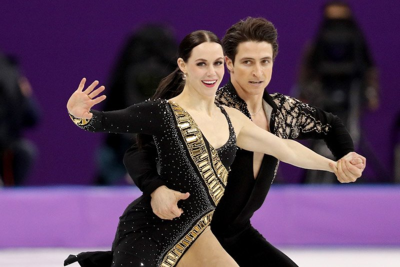 GANGNEUNG, SOUTH KOREA - FEBRUARY 11: Tessa Virtue and Scott Moir of Canada compete in the Figure Skating Team Event - Ice Dance - Short Dance on day two of the PyeongChang 2018 Winter Olympic Games at Gangneung Ice Arena on February 11, 2018 in Gangneung, South Korea. (Photo by Maddie Meyer/Getty Images)