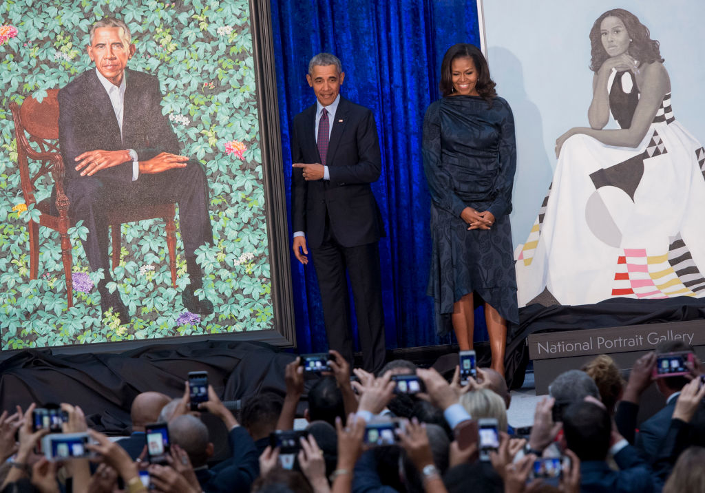 the Obamas with their portraits