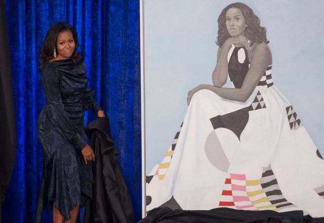 Former US First Lady Michelle Obama unveils her portrait at the Smithsonian's National Portrait Gallery in Washington.