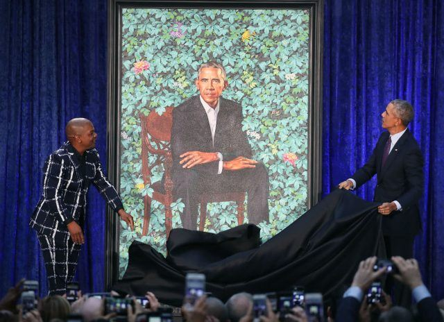Former U.S. President Barack Obama and artist Kehinde Wiley unveil his portrait during a ceremony at the Smithsonian's National Portrait Gallery
