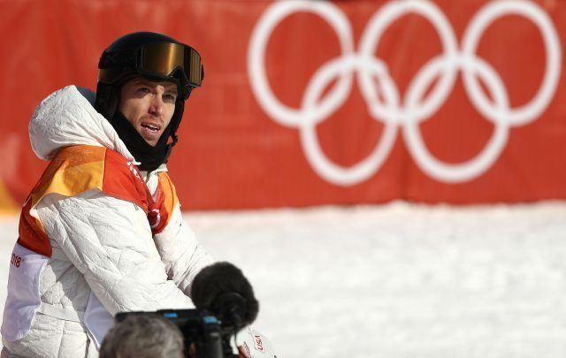 Shaun White standing in his athletic gear.