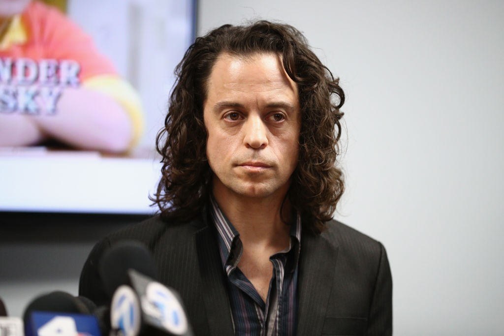 """Alexander Polinsky speaks during a press conference with his attorney Lisa Bloom regarding sexual harassment allegations against Scott Baio at The Bloom Firm on February 14, 2018 in Woodland Hills, California. Polinsky is the second person, along with Nicole Eggert, to costarred with Baio in the 1980's sitcom """"Charles in Charge"""" who have accused him of sexual harassment. Both Polinsky and Eggert were minors at the time."""