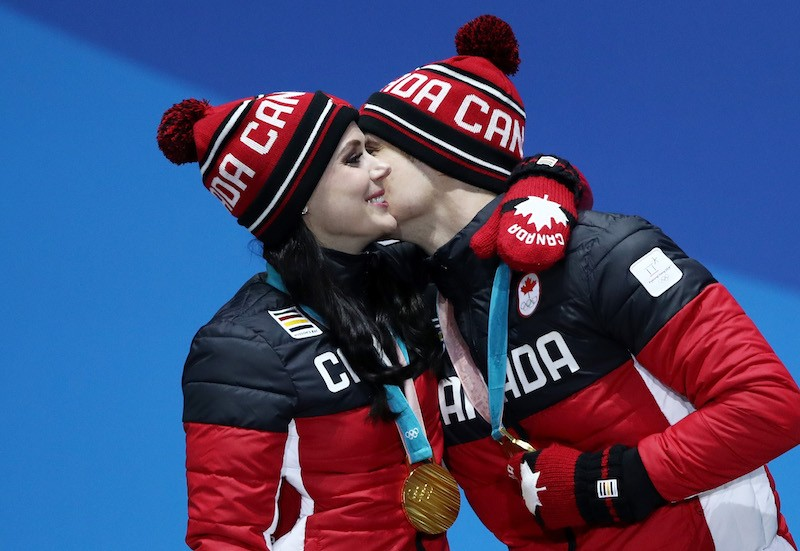 PYEONGCHANG-GUN, SOUTH KOREA - FEBRUARY 20: Gold medalists Tessa Virtue and Scott Moir of Canada celebrate during the medal ceremony for Figure Skating - Ice Dance Free Dance on day 11 of the PyeongChang 2018 Winter Olympic Games at Medal Plaza on February 20, 2018 in Pyeongchang-gun, South Korea. (Photo by Ezra Shaw/Getty Images)