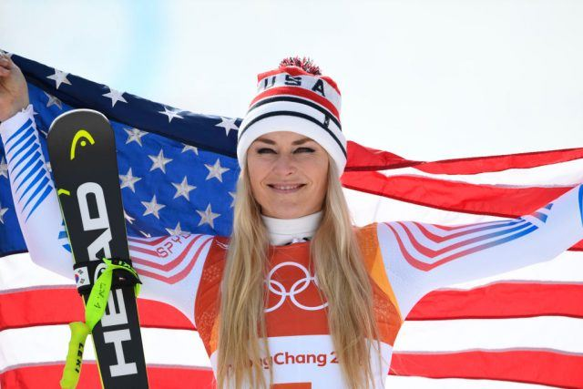 Lindsey Vonn posing with the American flag.